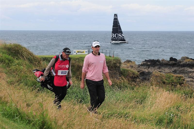 TURNBERRY, SCOTLAND - JULY 18:  Oliver Wilson of England walks up the 9th hole with his caddie Richard Hill during round three of the 138th Open Championship on the Ailsa Course, Turnberry Golf Club on July 18, 2009 in Turnberry, Scotland.  (Photo by Stuart Franklin/Getty Images)