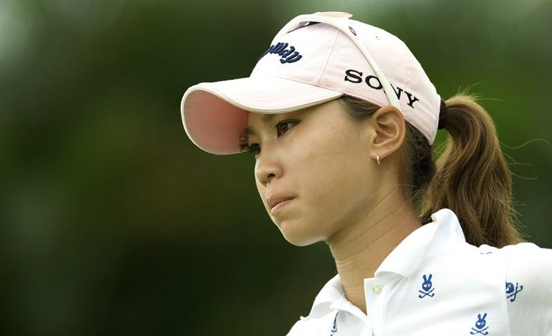 SINGAPORE - MARCH 07:  Momoko Ueda of Japan waits on the par tree 11th hole during the third round of HSBC Women's Champions at the Tanah Merah Country Club on March 7, 2009 in Singapore.  (Photo by Victor Fraile/Getty Images)
