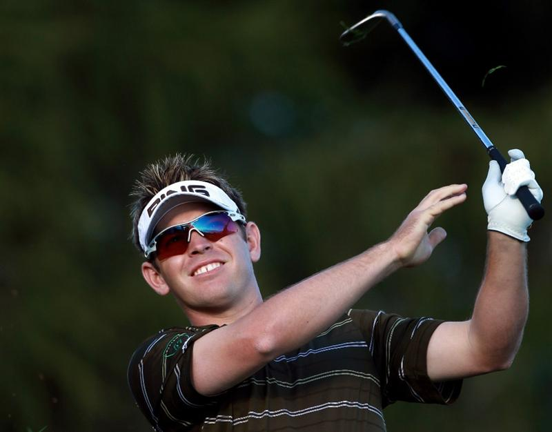 CRANS, SWITZERLAND - SEPTEMBER 03:  Louis Oosthuizen of South Africa reacts to his second shot on the 17th hole during the second round of The Omega European Masters at Crans-Sur-Sierre Golf Club on September 3, 2010 in Crans Montana, Switzerland.  (Photo by Warren Little/Getty Images)
