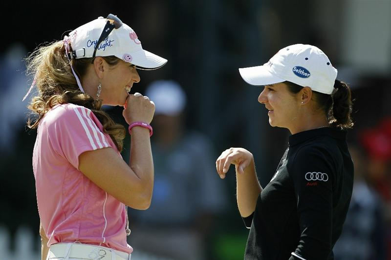 GUADALAJARA, MEXICO - NOVEMBER 11:  Lorena Ochoa of Mexico (R) has a laugh with Paula Creamer of the United States on the putting green during the first round of the Lorena Ochoa Invitational Presented by Banamex and Corona Light at Guadalajara Country Club on November 11, 2010 in Guadalajara, Mexico.  (Photo by Michael Cohen/Getty Images)