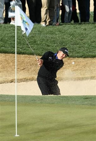 SCOTTSDALE, AZ - FEBRUARY 05:  Phil Mickelson chips out of the bunker onto the second hole green during the second round of the Waste Management Phoenix Open at TPC Scottsdale on February 5, 2011 in Scottsdale, Arizona.  (Photo by Christian Petersen/Getty Images)