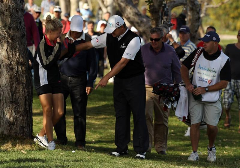 MALAGA, SPAIN - MARCH 26:  Paul Lawrie of Scotland stops a young spectator from stepping on hs ball on the 18th hole during the third round of the Open de Andalucia at the Parador de Malaga Golf Course on March 26, 2011 in Malaga, Spain.  (Photo by Ross Kinnaird/Getty Images)