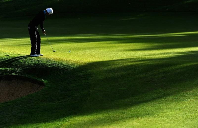 PARIS - SEPTEMBER 26: Chris Wood of England putting on the first hole during the final round of the Vivendi cup at Golf de Joyenval on September 26, 2010 in Chambourcy, near Paris, France.  (Photo by Stuart Franklin/Getty Images)
