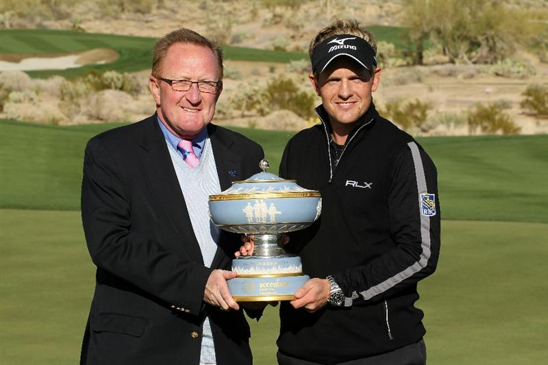 MARANA, AZ - FEBRUARY 27:  Luke Donald of England (R) and Richard Hills of the European Tour (L) celebrate with The Walter Hagen Cup trophy after winning his match 3-up on the 16th hole during the final round of the Accenture Match Play Championship at the Ritz-Carlton Golf Club on February 27, 2011 in Marana, Arizona.  (Photo by Andy Lyons/Getty Images)