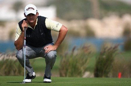 DOHA, QATAR - JANUARY 24:  Anton Haig of South Africa lines up a putt on the ninth green during the first round of the Commercialbank Qatar Masters at Doha Golf Club on January 24, 2008 in Doha, Qatar.  (Photo by Andrew Redington/Getty Images)
