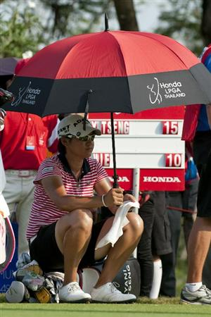 CHON BURI, THAILAND - FEBRUARY 20:  Yani Tseng of Taiwan sits on her golg bag on the 18th tee during day four of the LPGA Thailand at Siam Country Club on February 20, 2011 in Chon Buri, Thailand.  (Photo by Victor Fraile/Getty Images)
