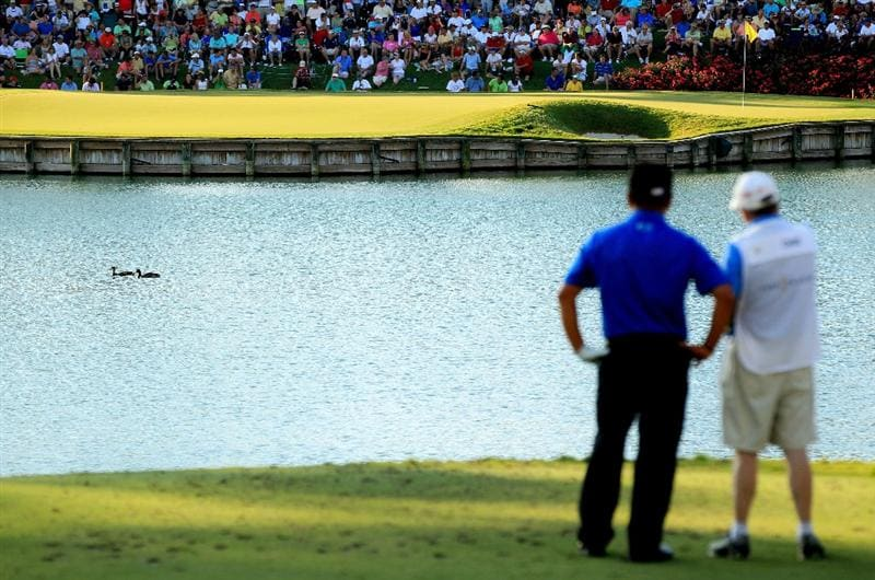 PONTE VEDRA BEACH, FL - MAY 15:  K.J. Choi of South Korea and caddie Andy Prodger look on from the 17th tee during the final round of THE PLAYERS Championship held at THE PLAYERS Stadium course at TPC Sawgrass on May 15, 2011 in Ponte Vedra Beach, Florida.  (Photo by Streeter Lecka/Getty Images)