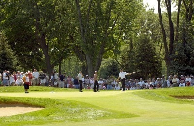 Fans watch as Jerry Kelly putts on the ninth green during the continuation of the first round of the U.S. Bank Championship in Milwaukee at Brown Deer Park Golf Course in Milwaukee, Wisconsin, on July 28, 2006.Photo by Steve Levin/WireImage.com