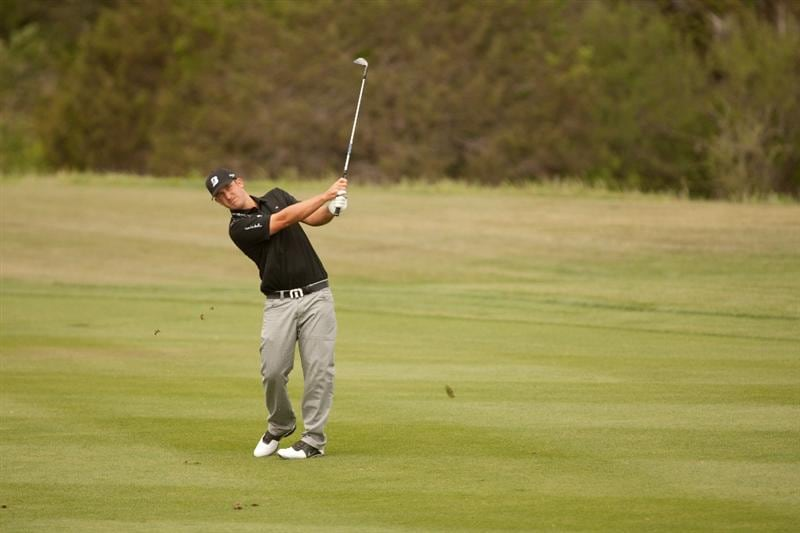 SAN ANTONIO, TX - APRIL 17: Kevin Chappell follows through on an approach shot during the final round of the Valero Texas Open at the AT&T Oaks Course at TPC San Antonio on April 17, 2011 in San Antonio, Texas. (Photo by Darren Carroll/Getty Images)