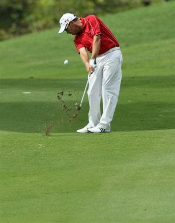 KUALA LUMPUR, MALAYSIA - OCTOBER 31: Brian Davis of England plays his 2nd shot on the 18th hole during day four of the CIMB Asia Pacific Classic at The MINES Resort & Golf Club on October 31, 2010 in Kuala Lumpur, Malaysia. (Photo by Stanley Chou/Getty Images)