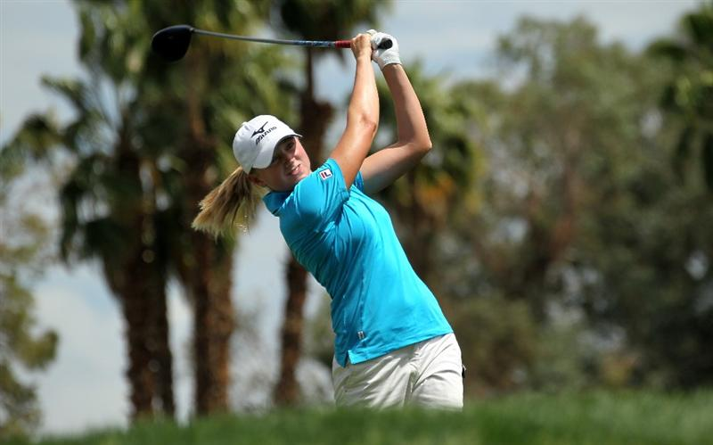 RANCHO MIRAGE, CA - APRIL 02:  Stacy Lewis hits her tee shot on the third hole during the third round of the Kraft Nabisco Championship at Mission Hills Country Club on April 2, 2011 in Rancho Mirage, California.  (Photo by Stephen Dunn/Getty Images)