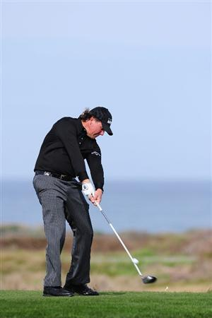 PEBBLE BEACH, CA - FEBRUARY 11:  Phil Mickelson plays a shot on #11 during round one of the AT&T Pebble Beach National Pro-Am at Monterey Peninsula Country Club Shore Course on February 11, 2010 in Pebble Beach, California.  (Photo by Stuart Franklin/Getty Images)