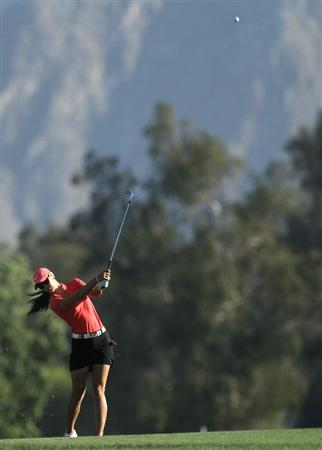 RANCHO MIRAGE, CA - APRIL 03:  Michelle Wie hits her approach shot on the 18th hole during the final round of the Kraft Nabisco Championship at Mission Hills Country Club on April 3, 2011 in Rancho Mirage, California.  (Photo by Stephen Dunn/Getty Images)