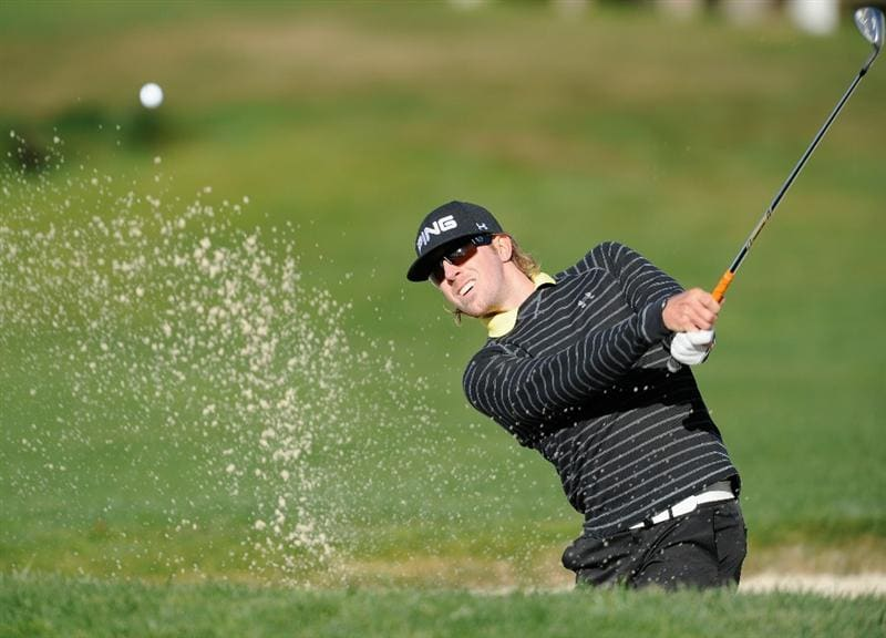 PEBBLE BEACH, CA - FEBRUARY 13:  Hunter Mahan plays his bunker shot on the second hole during the final round of the AT&T Pebble Beach National Pro-Am at Pebble Beach Golf Links on February 13, 2011  in Pebble Beach, California.  (Photo by Stuart Franklin/Getty Images)