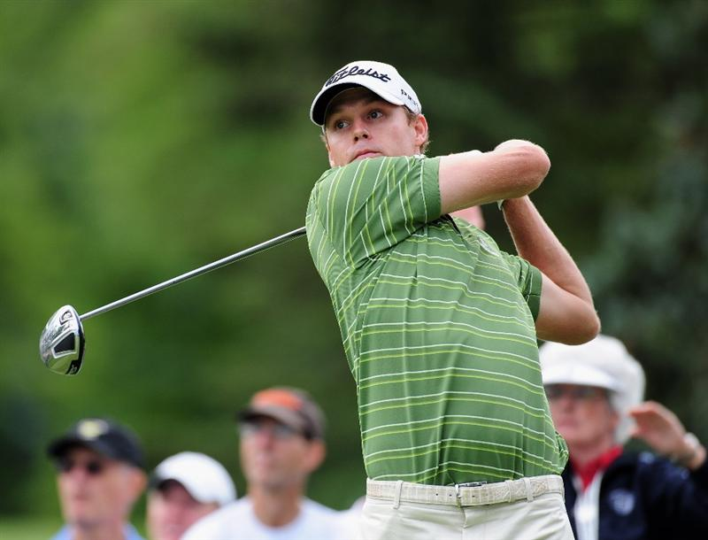 AKRON, OH - AUGUST 05:  Nick Watney of USA plays his tee shot during a practice round of the World Golf Championship Bridgestone Invitational on August 5, 2009 at Firestone Country Club in Akron, Ohio.  (Photo by Stuart Franklin/Getty Images)