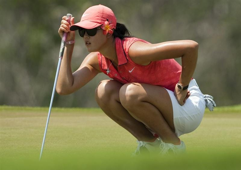 CHON BURI, THAILAND - FEBRUARY 20:  Michelle Wie of USA lines up a putt on the 4th hole during day four of the LPGA Thailand at Siam Country Club on February 20, 2011 in Chon Buri, Thailand.  (Photo by Victor Fraile/Getty Images)