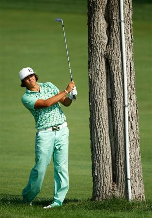 DUBLIN, OH - JUNE 04:  Rickie Fowler hits his approach shot on the 18th hole during the second round of the Memorial Tournament presented by Morgan Stanley at Muirfield Village Golf Club on June 4, 2010 in Dublin, Ohio.  (Photo by Scott Halleran/Getty Images)
