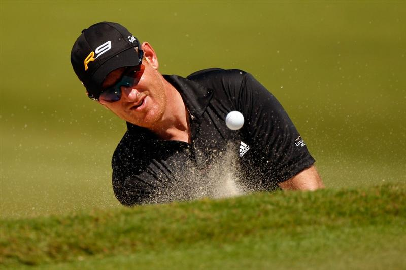 RIVIERA MAYA, MEXICO - MARCH 01:  Greg Owen chips out of a bunker on the third hole during the final round of the Mayakoba Golf Classic on March 1, 2009 at El Camaleon Golf Club in Riviera Maya, Mexico.  (Photo by Chris Graythen/Getty Images)