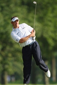 AKRON, OH - AUGUST 03:  Lee Westwood of England watches his approach shot on the 18th hole during final round of the World Golf Championship Bridgestone Invitational on August 3, 2008 at Firestone Country Club in Akron, Ohio.  (Photo by Stuart Franklin/Getty Images)