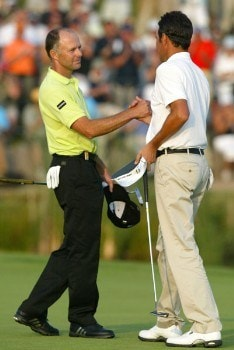 Jean Francois Remesy (FRA) and Jean Van de Velde (FRA)  congratulate each others as they enter the playoff during the fourth and final round of the Open de France as part of the European PGA circuit at St Quentin near Paris, France 26 JUNE 2005Photo by Alexanderk/WireImage.com