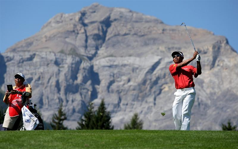 CRANS, SWITZERLAND - SEPTEMBER 06:  Thongchai Jaidee of Thailand watches his second shot on the 12th hole during the final round of The Omega European Masters at Crans-Sur-Sierre Golf Club on September 6, 2009 in Crans Montana, Switzerland.  (Photo by Andrew Redington/Getty Images)