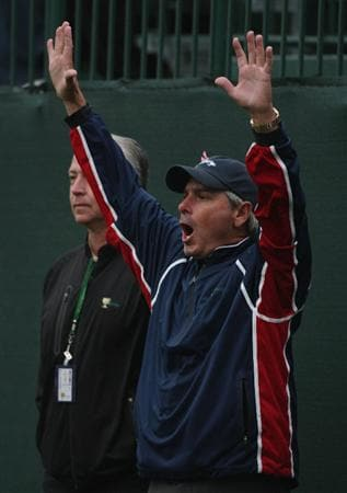 SAN FRANCISCO - OCTOBER 10:  Fred Couples, Captain of the USA Team celebrates a shot into the 16th green by Phil Mickelson during the Day Three Afternoon Fourball Matches of The Presidents Cup at Harding Park Golf Course on October 10, 2009 in San Francisco, California.  (Photo by Warren Little/Getty Images)