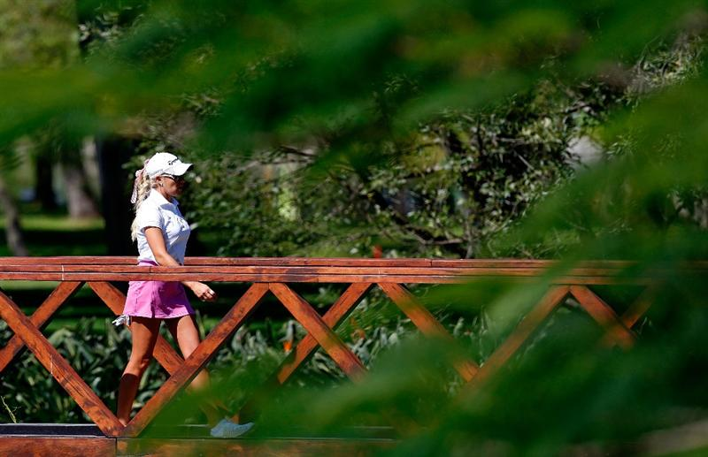 GUADALAJARA, MEXICO - NOVEMBER 12:  Natalie Gulbis of the United States walks to the second tee during the first round of the Lorena Ochoa Invitational Presented by Banamex and Corona at Guadalajara Country Club on November 12, 2009 in Guadalajara, Mexico.  (Photo by Kevin C. Cox/Getty Images)