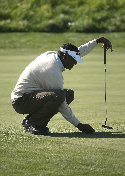 PEBBLE BEACH, CA - FEBRUARY 09:  Vijay Singh of Fiji sets his ball on the third green during the third round of the AT&T Pebble Beach National Pro-Am on February 9, 2008 at Spyglass Hill Golf Course in Pebble Beach. California.  (Photo by Stephen Dunn/Getty Images)