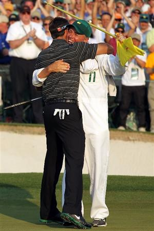 AUGUSTA, GA - APRIL 10:  Charl Schwartzel of South Africa celebrates his two-stroke victory with his caddie Greg Hearmon on the 18th green during the final round of the 2011 Masters Tournament at Augusta National Golf Club on April 10, 2011 in Augusta, Georgia.  (Photo by Jamie Squire/Getty Images)