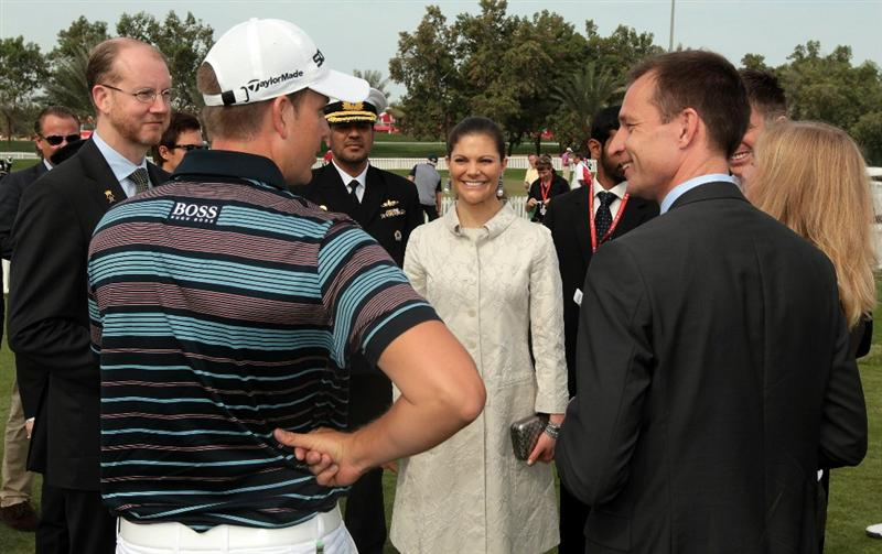 ABU DHABI, UNITED ARAB EMIRATES - JANUARY 20:  Princess Victoria of Sweden accompanied by the Swedish Ambassador to The UAE Mr Magnus Scholdtz (right) meet star professional golfer Henrik Stenson of Sweden before he teed off in the first round of the 2011 Abu Dhabi HSBC Golf Championship to be held at the Abu Dhabi Golf Club on January 20, 2011 in Abu Dhabi, United Arab Emirates.  (Photo by David Cannon/Getty Images)
