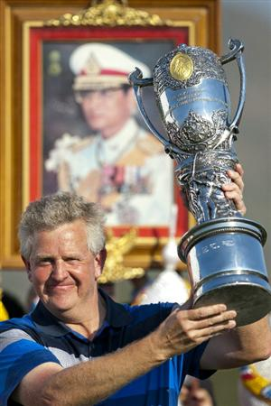 HUA HIN, THAILAND - JANUARY 09: Colin Montgomerie of Scotland poses with The Royal Trophy after winning The Royal Trophy tournament, at Black Mountain Golf Club on January 9, 2011 in Hua Hin, Thailand.  (Photo by Athit Perawongmetha/Getty Images)