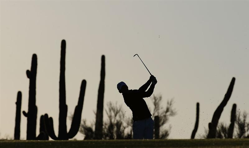 MARANA, AZ - FEBRUARY 16:  Paul Casey of England plays a shot during the second practice round prior to the start of the Accenture Match Play Championship at the Ritz-Carlton Golf Club on February 16, 2010 in Marana, Arizona.  (Photo by Stuart Franklin/Getty Images)