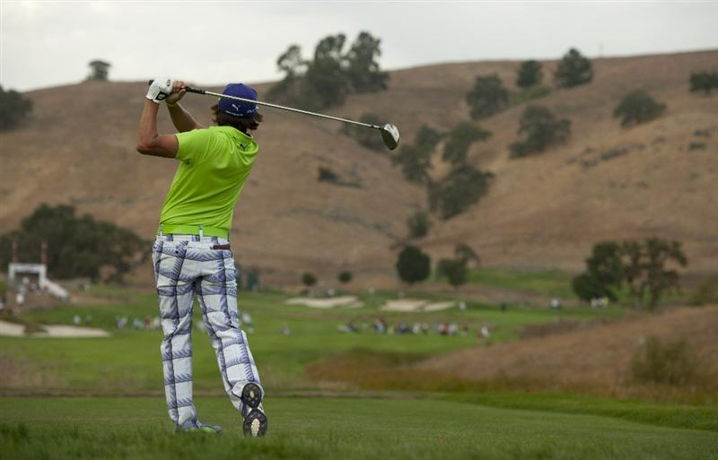 SAN MARTIN, CA - OCTOBER 16:  Rickie Fowler makes a tee shot on the 15th hole during the third round of the Frys.com Open at the CordeValle Golf Club on October 16, 2010 in San Martin, California.  (Photo by Robert Laberge/Getty Images)