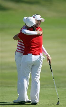 LA JOLLA, CA - SEPTEMBER 20:  Na Yeon Choi of South Korea hugs Jiyai Shin of South Korea after her -16 under par victory during the final round of the LPGA Samsung World Championship on September 20, 2009 at Torrey Pines Golf Course in La Jolla, California.  (Photo By Donald Miralle/Getty Images)