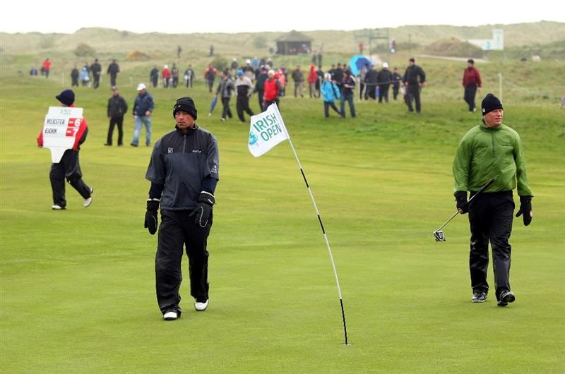 BALTRAY, IRELAND - MAY 16:  Thomas Bjorn of Denmark (left) and Peter Hedblom of Sweden (right) walk off the course as play is suspended due to high winds during the third round of The 3 Irish Open at County Louth Golf Club on May 16, 2009 in Baltray, Ireland.  (Photo by Andrew Redington/Getty Images)
