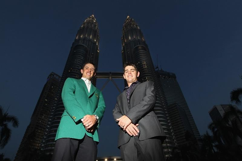 KUALA LUMPUR, MALAYSIA - APRIL 13:  Charl Schwartzel and Louis Oosthuizen of South Africa poses for photos outside the Petronas Towers prior to the Maybank Malaysian Open at Kuala Lumpur Golf & Country Club on April 13, 2011 in Kuala Lumpur, Malaysia.  (Photo by Ian Walton/Getty Images)
