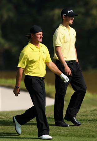 SHENZHEN, CHINA - NOVEMBER 27:  Alex Cejka and Martin Kaymer of Germany look on during the first round of the Omega Mission Hills World Cup at the Mission Hills Resort on 27 November 2008 in Shenzhen, China.  (Photo by Stuart Franklin/Getty Images)