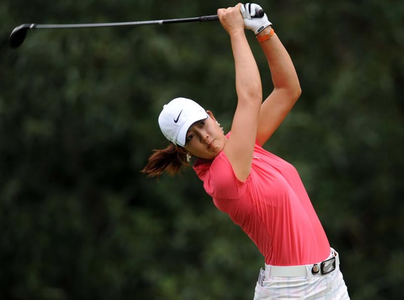 NORTH PLAINS, OR - AUGUST 28: Michelle Wie tees of on the seventh hole during the first round of the Safeway Classic on August 28, 2009 at Pumpkin Ridge Golf Club in North Plains, Oregon. (Photo by Steve Dykes/Getty Images)