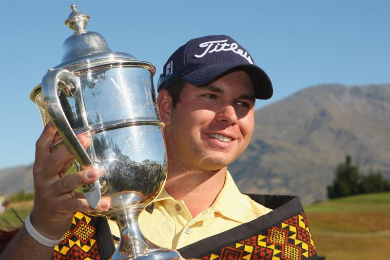 QUEENSTOWN, NEW ZEALAND - JANUARY 31:  Robert Gates of the USA poses with the winners trophy following day four of the New Zealand Open at The Hills Golf Club on January 31, 2010 in Queenstown, New Zealand.  (Photo by Phil Walter/Getty Images)