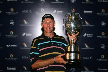 PAARL, SOUTH AFRICA - DECEMBER 16:  James Kingston of South Africa poses with the trophy after winning The South African Airways Open with a score of -4 par at Pearl Valley Golf Club on December 16, 2007 in Paarl, South Africa.  (Photo by Warren Little/Getty Images)