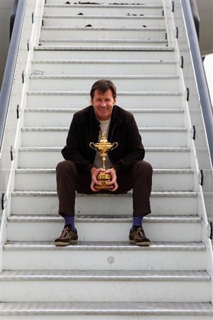 LONDON - SEPTEMBER 15:  Ryder Cup captain Nick Faldo poses with the Trophy at Heathrow airport before heading to the United States with Team Europe for the Ryder Cup on September 15, 2008 in London, England. The 2008 Ryder Cup will be held at Valhalla Golf Club in Louisville, Kentucky over the weekend of 19-21 September.  (Photo by Andrew Redington/Getty Images)