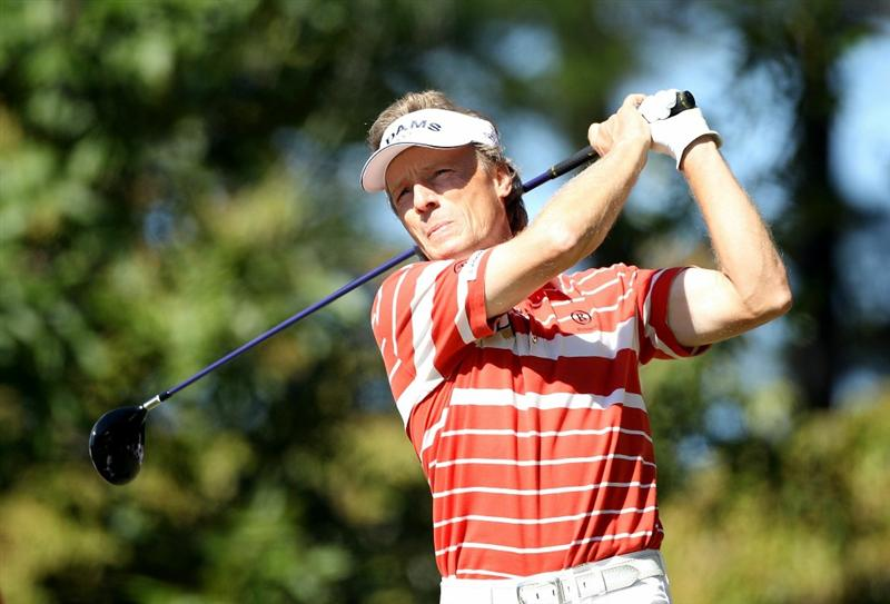 CONOVER, NC - OCTOBER 02:  Bernhard Langer of Germany hits a tee shot on the fourth hole during the second round of the Ensure Classic at the Rock Barn Golf & Spa on October 2, 2010 in Conover, North Carolina.  (Photo by Christian Petersen/Getty Images)