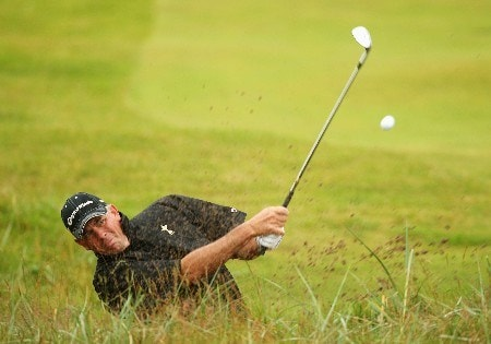 CARNOUSTIE, UNITED KINGDOM - JULY 19:  Tom Lehman of USA hits a bunker shot on the 2nd hole during the first round of The 136th Open Championship at the Carnoustie Golf Club on July 19, 2007 in Carnoustie, Scotland.  (Photo by Ross Kinnaird/Getty Images)