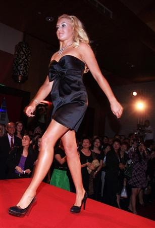 SINGAPORE - MARCH 04:  Natalie Gulbis of the USA walks onto the catwalk during the welcome reception at the Asian Civilisations Museum prior to the start of the HSBC Women's Championship on March 4, 2009 in Singapore  (Photo by Scott Halleran/Getty Images)
