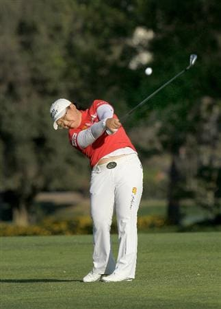 CARLSBAD, CA - MARCH 28:  Jiyai Shin of South Korea hits her second shot on the 18th hole during the final round of the Kia Classic Presented by J Golf at La Costa Resort and Spa on March 28, 2010 in Carlsbad, California.  (Photo by Stephen Dunn/Getty Images)