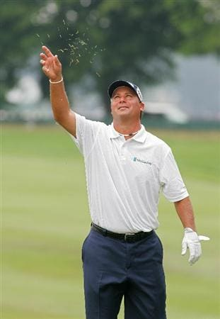 CROMWELL, CT - JUNE 27:  Chris DiMarco tosses grass in the air on the ninth hole during the final round of the Travelers Championship held at TPC River Highlands on June 27, 2010 in Cromwell, Connecticut.  (Photo by Michael Cohen/Getty Images)