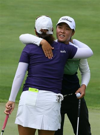 GLADSTONE, NJ - MAY 22: Haeji Kang (R) of South Korea hugs Jee Young Lee of South Korea after winning the match on the 18th hole during the third round of the Sybase Match Play Championship at Hamilton Farm Golf Club on May 22, 2010 in Gladstone, New Jersey. (Photo by Hunter Martin/Getty Images)