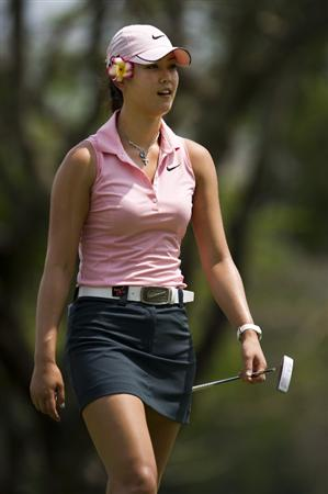 CHON BURI, THAILAND - FEBRUARY 20:  Michelle Wie of USA smiles on the 2nd green during round three of the Honda PTT LPGA Thailand at Siam Country Club on February 20, 2010 in Chon Buri, Thailand.  (Photo by Victor Fraile/Getty Images)