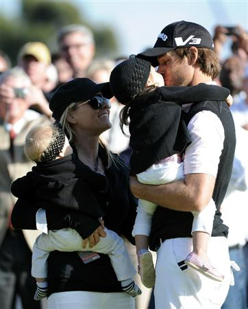 PACIFIC PALISADES, CA - FEBRUARY 20:  Aaron Baddeley of Australia celebrates his win with daughter Jewell, wife Richelle and daughterJolee on the side of the 18th green during the fourth round of the Northern Trust Open at the Riviera Country Club on February 20, 2011 in Pacific Palisades, California.  (Photo by Harry How/Getty Images)