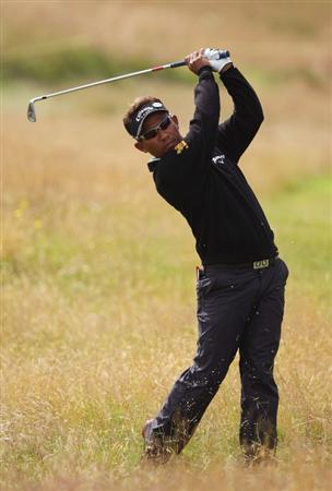 TURNBERRY, SCOTLAND - JULY 14:   Thongchai Jaidee of Thailand hits from the rough on the 2nd hole during a practice round prior to the 138th Open Championship on the Ailsa Course, Turnberry Golf Club on July 14, 2009 in Turnberry, Scotland.  (Photo by David Cannon/Getty Images)